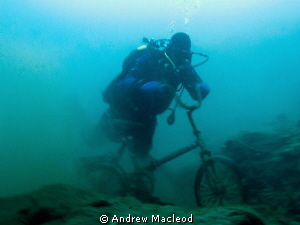 A bike in lake Baikal by Andrew Macleod